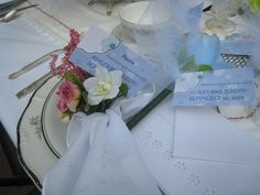 Table Setting. Mix-Matched china and hankie wrapped with flowers for napkins