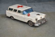 """Collectible Decor Vintage IB Trademark Litho White Ambulance Car Tin Toy  Get it from our online store:  Singhalexportsjodhpur.Com and search for """"33554"""" in the search box  Use code EARLYBRD5 to get amazing discounts.  LALJI HANDICRAFTS - WORLDWIDE SHIPPING - EXCLUSIVE HANDICRAFTS  INDIAN DECOR INDUSTRIAL DECOR VINTAGE DECOR POP ART MOVIE POSTERS VINTAGE MEMORABILIA FRENCH REPLICA  #oldtoy #oldtoys #tintoy #raretoy #tintoys#toycar #toycars #giftsformen tincars #giftideasforher…"""
