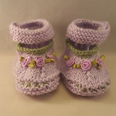 "Our knitted baby booties keep your baby's little feet warm and comfy. They're knitted from soft wool that doesn't irritate your baby's skin. Material: Acrylic, Polyamide Please, visit our ""Size Chart"""