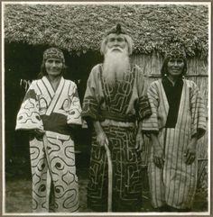 Aino family in front of the entrance to a house, Japan – Aino, Hokkaido. Photographer: Aage Henriksen
