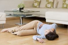 A woman collapses to the floor due to cataplexy in narcolepsy type 1