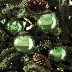 Green Mercury Glass Ornaments and Pinecones work wonderfully together.I need these! My mom has these in different colors Star Wars tree theme