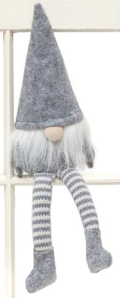 Sweet little Christmas gnomes with long legs sit perfectly on a shelf. Move it…