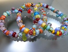 Elastic bracelets with handmade glass beads and sterling silver by www.melaniemoertel.com