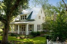 Forget your oversized comtemporary, some of prefer a quaint, cozy cottage...with a great front porch.