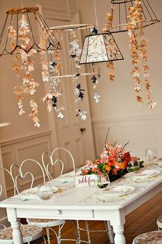 Floral-inspired garlands make this dining room come to life and has such a romantic feel to it.