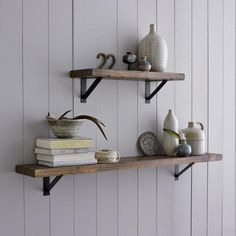 remoldelista: Salvaged Wood Shelf with iron brackets.