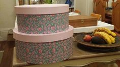 Storage solution in the kitchen - Vintage Hat Boxes to store baking tins - adds a touch of glamour