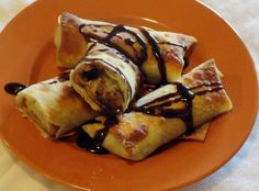 Peanut Butter - Banana Rolls Bananas, Honey, Ginger & Peanut Butter wrapped in egg roll wrappers and baked 12 minutes at 425 degrees!