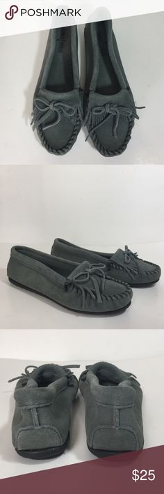 Minnetonka Moccasin Suede Flats Rich suede is crafted into a cool, classic moccasin styled with a fringed accent and contrast whipstitching. A lightweight sole offers traction and longevity. Gently loved. In great condition. Grayish blue color. Minnetonka Shoes Moccasins