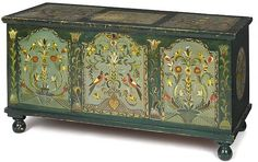 """Pennsylvania painted pine dower chest, 19th c., with a later decorated surface, 26"""" h., 48"""" w."""