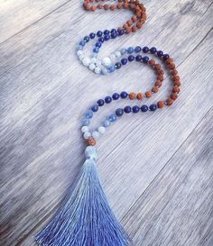 Sacred Water Mala Water more than sustains—it is a sacred, living thing to be revered and protected. 108 bead, hand knotted, mala necklace made from 6mm Rudraksha seeds and various semi precious stones. Gemstones: Blue Sponge Quartz ~ Blue Aventurine ~ Lapis Lazulli ~ Snow Quartz ~ Care For Your Mala ♥ Please treat your jewelry gently, as some materials can be extremely fragile. Although every effort has been made to ensure the strongest materials were used, it is essential to treat