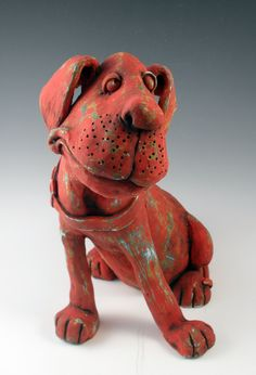 Earthenware dog with velvet underglaze layered in three colors.  Hand built with coils and slabs