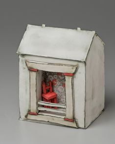 """""""Mary Fischer's ceramic forms are reminiscent of the landsettled by her great-grandparents and where Fischer grew up. Her sculptures of barns, water towers, granaries and other farm buildings are influenced by her surroundings on the Texas landscape."""""""