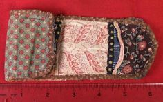 Antique sewing kit / housewife. Would really like those exact fabrics.