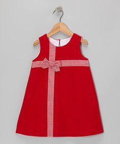 Perfect for a petite princess, this versatile dress can be worn alone on warm days or layered over a top and sported as a jumper. Buttons in back fulfill fantasies of slipping it on simply.