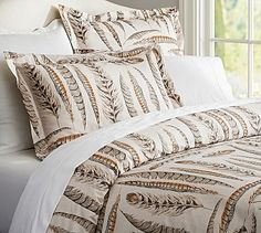 Feather Duvet Cover and Sham- super cool! Maybe for a guest bed?