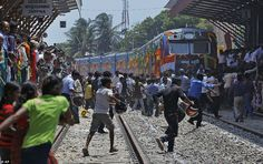 24 years after the 'Queen of Jaffna' was suspended due to the civil war, the train arrives in Jaffna station in Northern Sri Lanka 13th Oct 2014