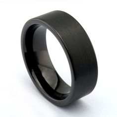 This Men's Ring - The Black Ash $85 - has a matted finish for that natural black stone look. With it's simple masculine design it makes an incredible wedding band or mens fashion ring. It features 6,8, & 10mm band widths.-  Tungsten