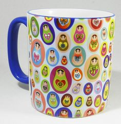 The Russian Dolls (Matryoshka) Mug on a 2 Tone Ceramic Mug. Lots of different styles and colours of Russian Nesting Dolls. A good quality ceramic mug which is dishwasher proof. Blue handle and rim Height is 9cm, diameter 8cm. From the Series 1 - The Original Line Range by Half A Donkey www.halfadonkey.co.uk