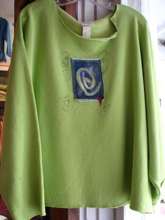 Remade sweatshirt with handpainted applique.
