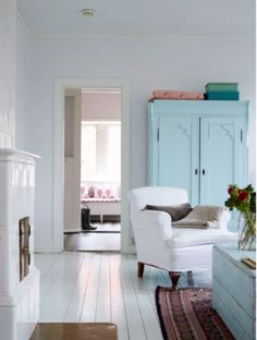 Duck egg blue renovated cupboard. with deeper shades of turquoise above.  Love it