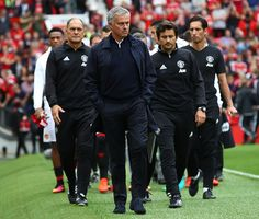 Jose Mourinho Manager of Manchester United and his backrroom team make their way…
