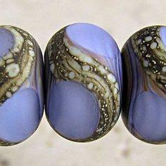 Lampwork silvered ivory swirl focal bead set. SpawnOfFlame