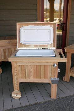 Cedar deck cooler with stainless steel bottle opener and cap catcher.