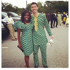 Interracial Nigerian couple bride white groom green Ankara outfit African print wedding