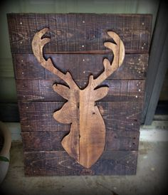 Stained recycled pallet deer silhouette. Approx.. 25 tall by 15 wide they all vary slightly because we use all recycled materials. If you need a
