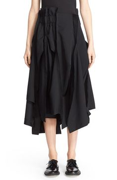 Free shipping and returns on Comme des Garçons Wool Gabardine Skirt at Nordstrom.com. Meticulous paneling and raised seam detailing bring structural sophistication to a fluid gabardine skirt topped with a partially elasticized waistband and finished with an asymmetrical hem.