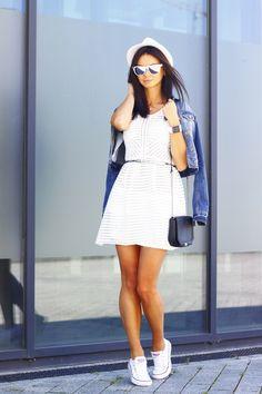 Shop this look on Lookastic:  https://lookastic.com/women/looks/denim-jacket-skater-dress-low-top-sneakers-crossbody-bag-hat-belt-sunglasses-watch/12981  — White Straw Hat  — Grey Sunglasses  — White Leather Watch  — Silver Leather Belt  — Blue Denim Jacket  — White Skater Dress  — Black Leather Crossbody Bag  — White Canvas Low Top Sneakers
