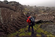 Photo by @shonephoto (Robbie Shone) - Hiking up Mount Etna as it was erupting in search of an unusual lava tube. This gigantic lava flow was mostly shrouded in cloud We stopped here to examine some twisted rope lava formations. During a pahoehoe flow the outer skin of lava cools and becomes viscous. The underlying lava is insulated and remains quite liquid. As it flows it carries the cooler skin along with it causing it to crumple and fold into twisted shapes. However early in the flow when…