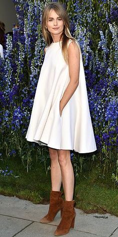 Cressida Bonas in a white tent dress and brown booties at the Dior spring 2016 fashion show