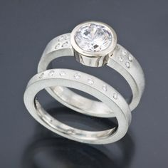 14k white gold engagement ring and wedding band set with accent diamonds by Douglas Zaruba. http://www.vortex13.com