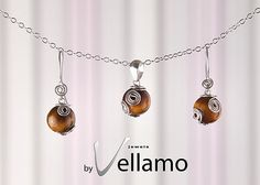 Earrings and pendant jewelry set with round tigers by byVellamo, $30.00