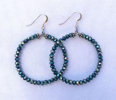 A personal favorite from my Etsy shop https://www.etsy.com/listing/453351294/teal-metallic-crystal-hoop-earrings