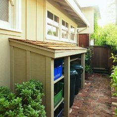 trash shed..nice and neat and tidy...great idea!