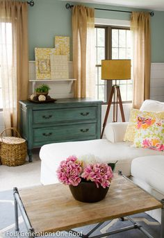 Like the curtains, color but sheer. LOVE the dresser, would like to copy that for the bedroom. And especially love the materials used for the coffee table