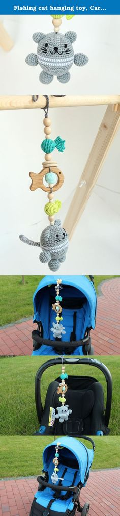 Fishing cat hanging toy, Car seat toy, Pram toy, stroller toy, crib toy, Baby Rattle, play gym toy, wooden teething toy, mobile. This hanging toy features a crochet cat with three fish. A fishing cat will add happiness and fun to your baby's plays and journeys. Your baby will get so much joy from the sensations, sounds and visual delights this toy gives. There's a small bell inside the cat so it makes pleasant sounds when a baby plays. Crochet animal is handcrafted with a fish shaped...