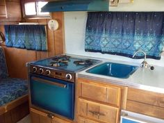 I LOVE the cobalt blue appliances and sink!