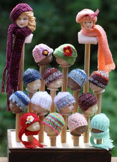 My hubby made this wonderful hat display for me.  All the heads are the same size as Barbie and Ken doll.  I don't have patterns, just ideas pop in my head and I knit to create it.  I love hats on dolls!  Hats are available.  Prices vary.