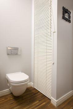 bathroom with hidden washing machine, Duravit Philipe Starck toilet
