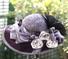 I made this vintage style hat shades of Purple and lilac hat in a wide brim Edwardian/Victorian High fashion vintage style using traditional millinery techniques. The crown is covered in a lilac, sequined floral patterned lace with a pleated taffeta band. The upper side of the brim (16.5 from front to back) is covered in a dark shade of plum purple. The underside of the brim is done in the same lilac taffeta fabric as is the pleated band. I used this same taffeta to do a binding around t...
