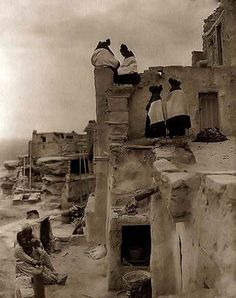 Here for your enjoyment is an inspiring photograph of Indian Pueble Housetop. It was made in 1906 by Edward S. Curtis.  The photo illustrates Women seated and standing on pueblo buildings.