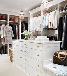 Chic walk-in closet design with crystal pendants over white closet island with brass hardware. Fabulous walk-in closet with white built in cabinets and shelves for shoes. Walk In Wardrobe, Walk In Closet, White Closet, Closet Space, Closet Rooms, Closet Redo, Closet Remodel, Winter Wardrobe, Dressing Room Closet