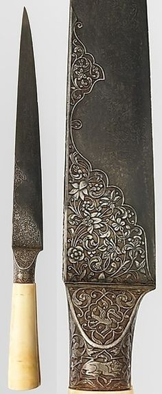 """Persian kard dagger,19th century, watered steel blade, ivory and gold, H. 15 1/2 in. (39.4 cm), Met Museum. """"Damascus"""" or """"Watered"""" steel refers to blades that have been given a wavy or """"watered"""" pattern, created by specific smelting and crucible techniques, prior to forging. The forte and hilt of this dagger are covered with chiseled decoration of floral motifs, arabesques and cartouches containing ducks and lions– ornament that can be found on a variety of media in later Persian art."""