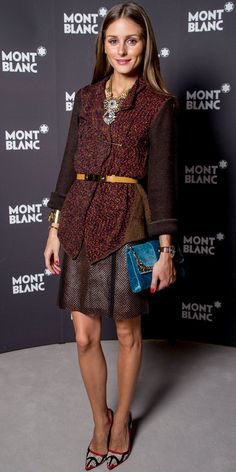 Olivia Palermo styled her Montblanc watch with a belted topper, mixed material necklace, perforated skirt, gold cuff, jeweled bag and leather Manolo Blahnik heels in Geneva.
