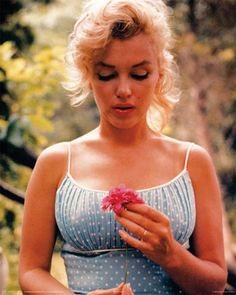 Beautiful Poster print 24x36 of a very classy Marilyn Monroe holding a flower.
